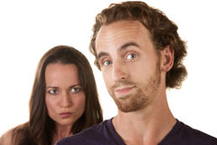 Sneaky Man with Skeptical Girlfriend Stock Photo