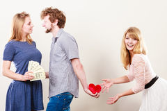 Sneaky man with two women. Cheating and cunning idea. Handsome sneaky men tricking rich women for his true love. Triangle concept Stock Images