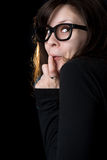 Sneaky, nerdy girl with thick glasses Royalty Free Stock Images