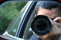 Sneaky Paparazzi. Paparazzi Security Shot royalty free stock photography