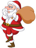 Sneaky santa. Claus showing silence sign and tip toeing carrying gifts sack Royalty Free Stock Image