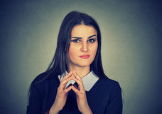 Sneaky, sly, scheming young woman plotting something Stock Photography