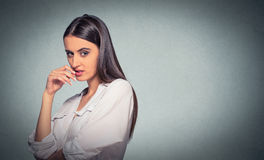 Sneaky, sly, scheming young woman plotting something Stock Images