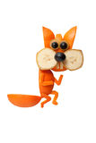 Sneaky squirrel made of orange. On isolated background Stock Photo