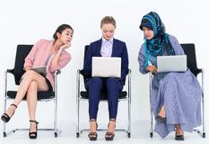 Two women is copying co worker work and idea. Sneaky Two women is copying co worker work and idea stock images