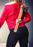 Sneaky woman holding axe chopper. False intention. Royalty Free Stock Images