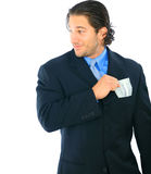 Sneaky Young Caucasian Businessman. Hiding money on his pocket. concept for corruption Stock Photo