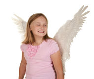 Sneaky young girl with angel wings Stock Photos