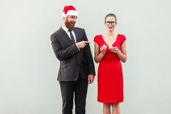 Sneer and mock concept. Man pointing fingers at woman and smilin Royalty Free Stock Photo