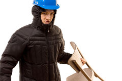 Sneering aggressive thug holding a wooden chair Stock Photography