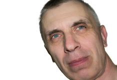 Sneering  Man. Studio shot of a dreamily looking man with a tilted head, isolated on white Stock Photo