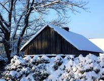 Sneeuw aan het buitenhuis Stock Afbeelding