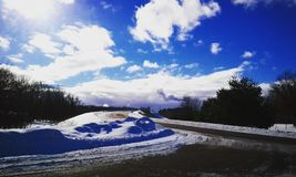 Sneeuw en zon Royalty-vrije Stock Afbeeldingen