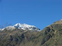 Sneeuw hoge bergpiek stock afbeeldingen