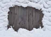 Sneeuw op een omheining stock foto