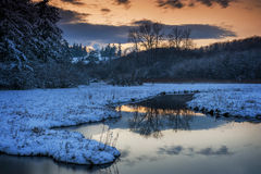 Sneeuweilandmoerasland bij Zonsondergang stock afbeelding