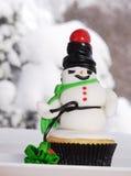 Sneeuwman cupcake Stock Afbeeldingen