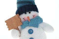 Sneeuwman dat leeg teken houdt Royalty-vrije Stock Afbeeldingen