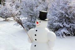 Sneeuwman in de sneeuw Stock Foto