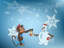Sneeuwman en aap Stock Afbeeldingen