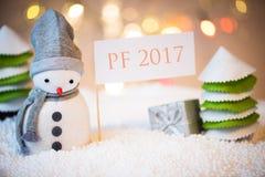 Sneeuwman met PF 2017 teken Stock Afbeelding
