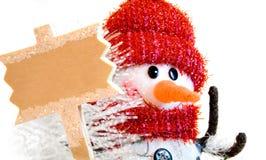 Sneeuwman met signage Royalty-vrije Stock Afbeeldingen