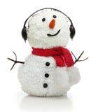 Sneeuwman in oortelefoons en rode sjaal Royalty-vrije Stock Foto