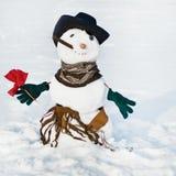 Sneeuwmannen met bloem Stock Foto's