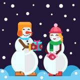 Sneeuwmannen met Kerstmisgift en Sneeuwmeisje Royalty-vrije Stock Fotografie
