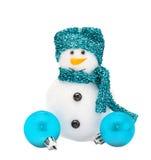 Sneeuwmannen met turkooise hoed en sjaal Stock Fotografie