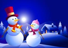 Sneeuwmanpaar bij de winternacht Royalty-vrije Stock Afbeelding
