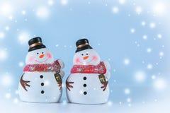 2 sneeuwmantribune op witte achtergrond Stock Foto