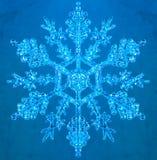 Sneeuwvlok op blauwe achtergrond Stock Foto