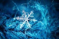 Sneeuwvlok op wol royalty-vrije stock afbeelding