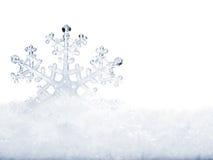Sneeuwvlok in sneeuw. Stock Afbeelding