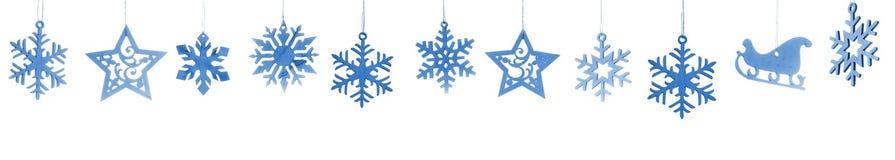 Sneeuwvlokken en sterren op witte achtergrond worden geïsoleerd die Stock Afbeelding