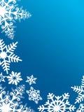 Sneeuwvlokken op blauw Stock Afbeeldingen