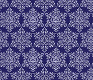 Sneeuwvlokken op een donkerblauwe background Naadloos patroon Royalty-vrije Stock Foto
