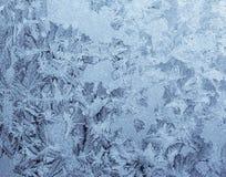 Sneeuwvlokken op het glas Stock Foto's