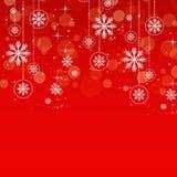 Sneeuwvlokken op rood stock afbeelding