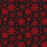 Sneeuwvlokken op zwarte en rode naadloze textuur als achtergrond royalty-vrije illustratie