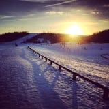 Sneeuwzonsondergang stock foto's