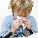 Sneeze. Young boy sneezing in a handkerchief, square close up Stock Images