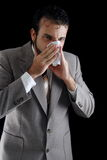 Sneeze. Businessman with a big influenza Stock Images