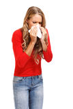 Sneeze. Young blond woman sneezes isolated on white stock photos