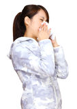 Sneeze asian young girl. Over white background Stock Photo