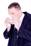 Sneeze... Businessman with a influenza Royalty Free Stock Image