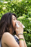 Sneeze I. Sniffing and sneezing, outside, park Stock Image