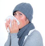Sneeze people. Sneezing woman with scarf having cold Royalty Free Stock Photo