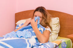 She sneezes with acute respiratory illness Royalty Free Stock Photo